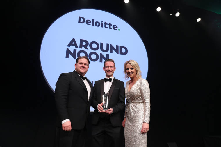Gareth Chambers (centre), CEO of Newry-based Around Noon collects the award for Around Noon at the Deloitte Best Managed Companies 2018 awards gala in Dublin.