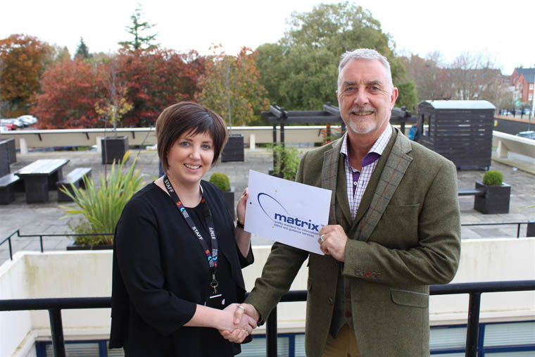 Lorraine McKeown SRC Assistant Director for Student Services and Marketing receiving the Matrix Award from Matrix Assessor Andy Richardson.