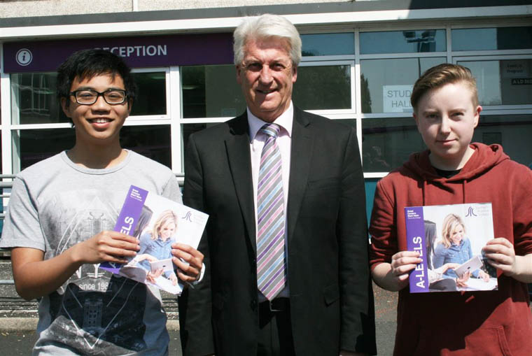 Head of School Michael McDonald with A Level students Janssen Garcia and Miles O'Neill