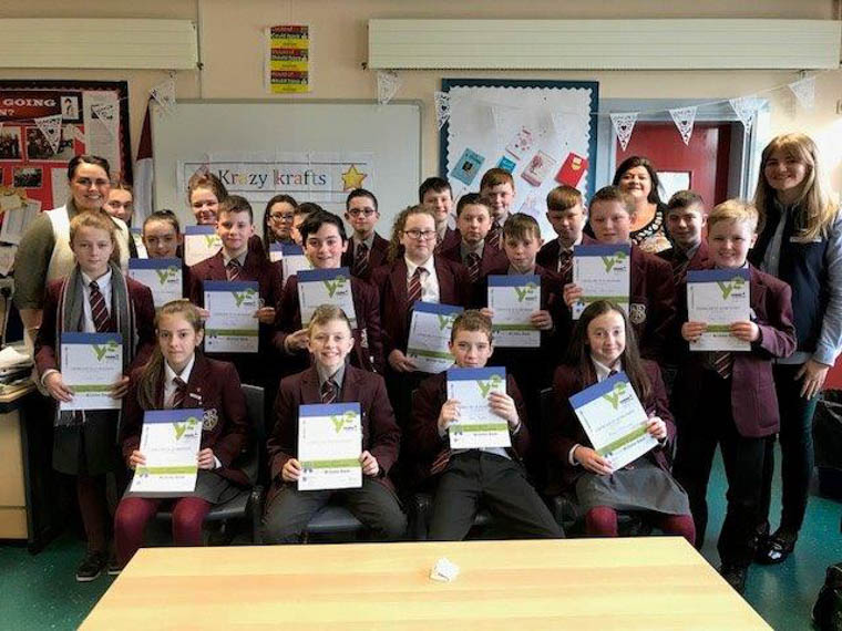 Students from St Paul's High School, Bessbrook celebrate the completion of the 'QuickStart Programme' this week with local charity Young Enterprise NI.