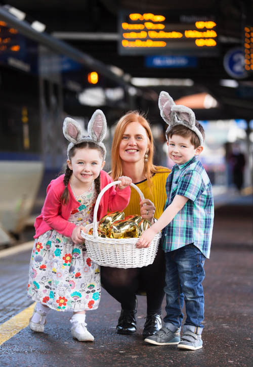 Translink's Claire Vaux announcing the 50th anniversary of Northern Ireland Railways (NIR) and cracking Easter fares with young passengers, Sophia Clarke and Finn Clarke