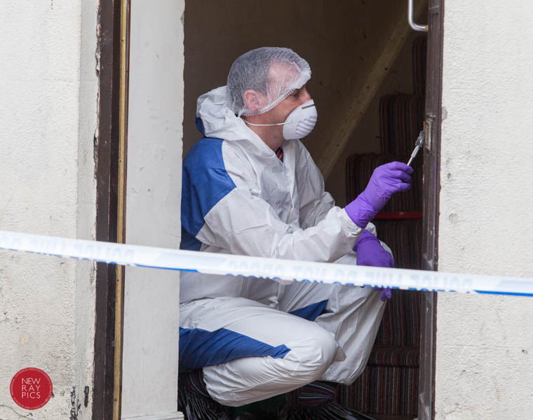 Forensics at work at Talbot Street, Newry after an aggravated burglary. Photograph: NewRayPics.com