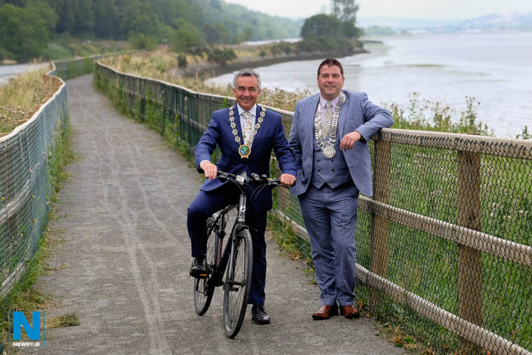 Cllr Mark Murnin, Chairman, Newry, Mourne and Down Council and Cllr Liam Reilly, Cathaoirleach, Louth County Council try out the new stretch of the Carlingford Lough Greenway between Victoria Lock and the Albert Basin in Newry, which was officially opened today. Photograph: Columba O'Hare/ Newry.ie
