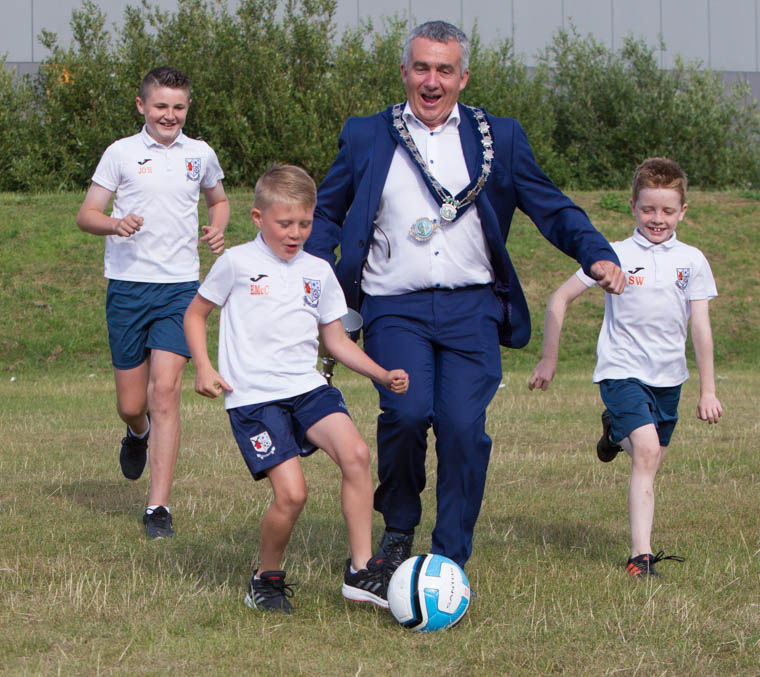 Chairman of Newry Mourne and Down District Council,  Cllr Mark Murnin  has a kick about with James O'Hanlon, Owen McCrink and Senan Watters at the launch of the Be Active Football Tournament. Photograph: NewRayPics.com
