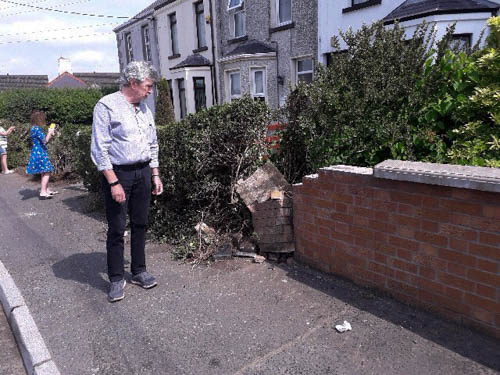 Mickey Brady MP as the scene of the crash on the Armagh Road in Newry.