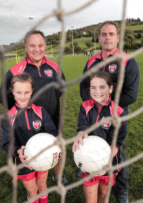 Rory Coffey, Carrickcruppen GAA with Dave Scott, Danske Bank and U10 ladies players Dearbhla Coffey and Hannah Scott.
