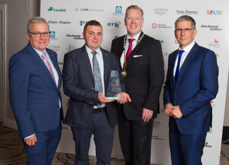 Overall Employee of the Year, Vladimir Mishurov from Deli Lites Ireland with Paul Convery, President of Newry Chamber, Colm Shannon, CEO of Newry Chamber and Mark Simpson, BBC Newsline Correspondent and host for the awards ceremony.
