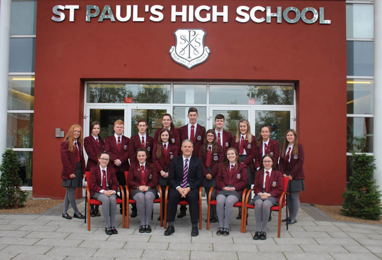 Top achievers at the St Paul's High School Prize Night. Back from left: Niamh Murphy, Tara Phillips, Liam Manly, Conor Murphy, Hannah Quinn, Jason McVerry, Conor Cinnamond, Cailiosa Ni Dhuill, Aoife Phillips, Tara Hollywood. Middle: Caoimhe Hanrahan and Orla Cromie. Front: Emma Mallon, Ciara O'Hagan, Jarlath Burns (Principal), Blinne McAteer and Sarah Mallon. Missing from the Photograph are Rhiannon Noade and Niamh Markey.