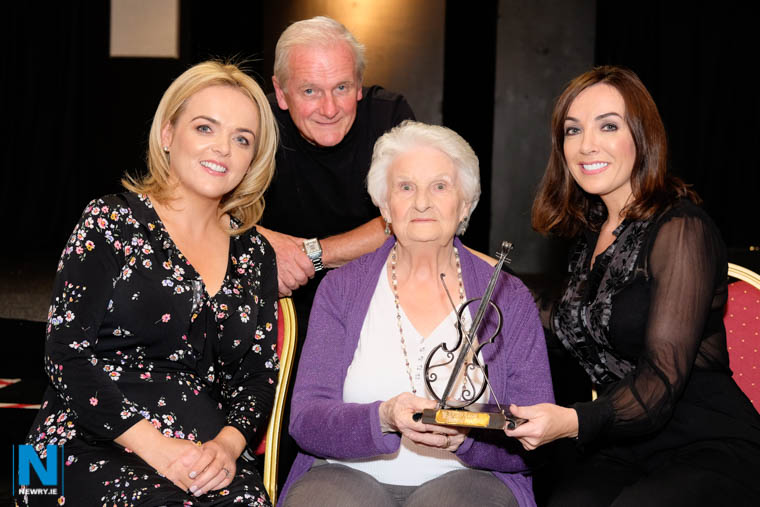 Organisers Claire Byrne and Tommy Fegan present the Iúr Cinn Fleadh Musical Icon Award to Josephine Keegan while looking on is musician Ursula Byrne. Photograph: Columba O'Hare/ Newry.ie