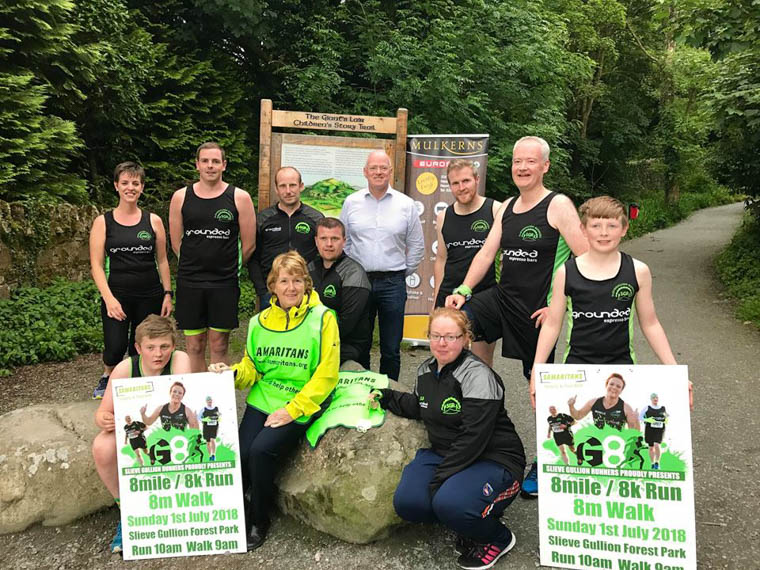 Terry Mulkerns,  Mulkerns' EUROSPAR and Slieve Gullion Runners Member with Eileen Winters, Samaritans Newry & Dundalk and Slieve Gullion Runners Club Members. Photograph: Elaine McCann
