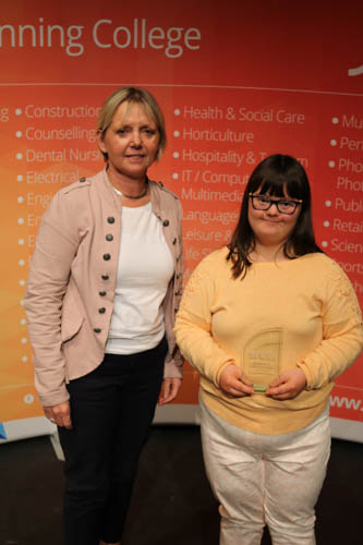 Katrina Magee receiving her award from Carolyn Davidson, SRC Head of School of Early Years and Healthcare. Katrina is from Newry and studies on the Asdan Entry Level Certificate in Personal and Social Development at Newry Campus.