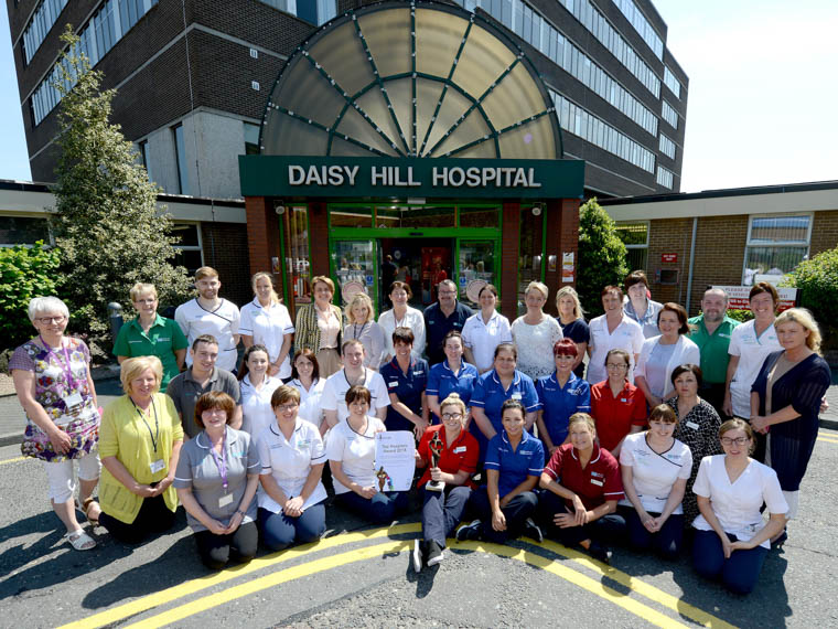 Southern Trust Chair Roberta Brownlee celebrating with staff at Daisy Hill Hospital. The Southern Trust's Acute Hospital network (Craigavon Area and Daisy Hill) is the only one in Northern Ireland to be recognised as one of the UK's Top hospitals for 2018.