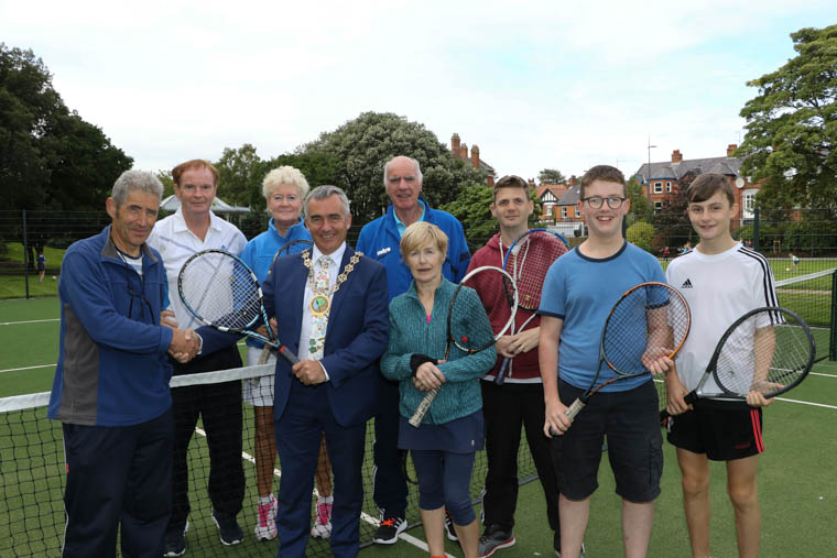 Chairman Newry, Mourne and Down Council, Councillor Mark Murnin meets members of Warrenpoint Tennis Club who staged an exhibition match to showcase the new surface in the multigame area of the park.