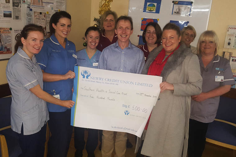 Noelle Jackson presents a cheque for £500 to the renal team at Daisy Hill Hospital.