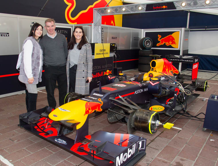 Louise Cunningham, First Derivatives, Rebecca Byrne and Eamonn Connolly, Newry BID get up close with the Formula 1 Car. Photograph: NewRayPics.com