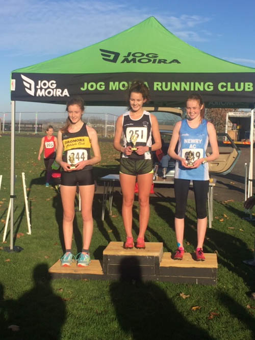Meadow McCauley (far right) lifting 2nd place at Moira Autumn Cross Country