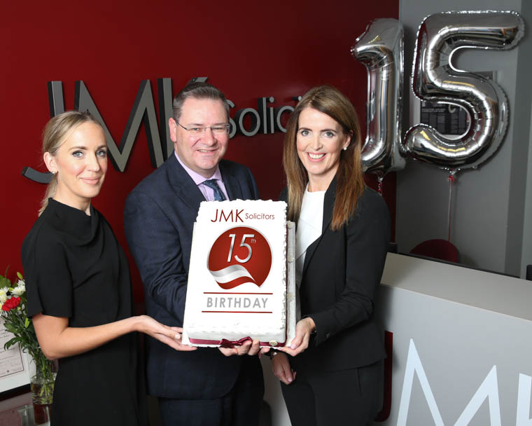 JMK Solicitors celebrate their 15th Birthday with record year. From left: Olivia Meehan, Legal Services Director, Jonathan McKeown, Chairman and Maurece Hutchinson, Managing Director.