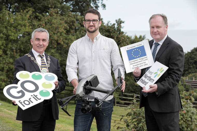 Celebrating the 200th Go For It Business Plan are Gavin Martin of Magnetic North Photography (centre), Chairman for Newry, Mourne and Down District Council, Councillor Mark Murnin (left) and Liam Quinn, Business Advisor with Newry & Mourne Enterprise Agency.