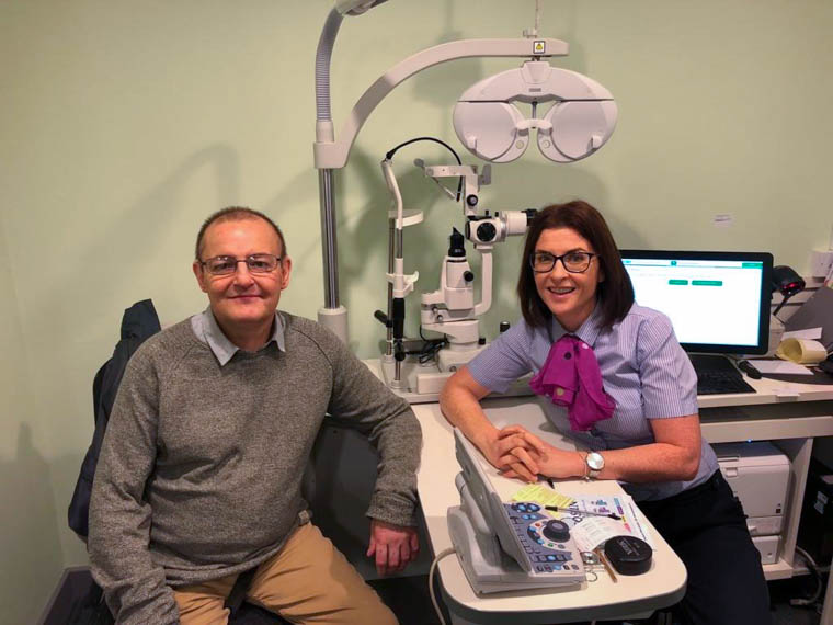 Peter Hoey with Specsavers optician, Alison Dunne, who detected an unknown internal bleed behind his eye.