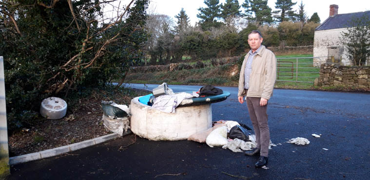 Cllr Mickey Larkin pictured at the scene  of the latest fly tipping in the proximity of Slieve Gullion.
