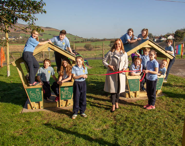 Newry, Mourne and Down District Council Deputy Chairperson, Councillor Oksana McMahon with the help of pupils from Jonesborough Primary School cuts the ribbon to open the refurbished play park.