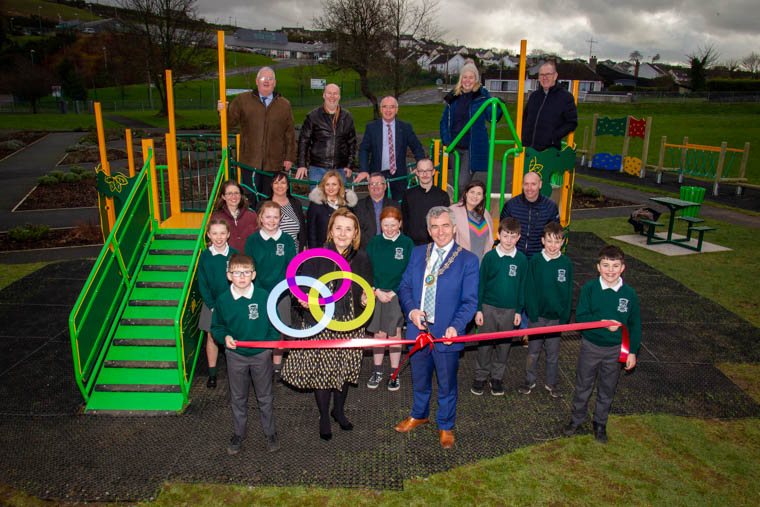 Newry, Mourne and Down District Council Chairman, Councillor Mark Murnin launches the new play park in Burren Village Green alongside children, teachers from the local school and local councillors.