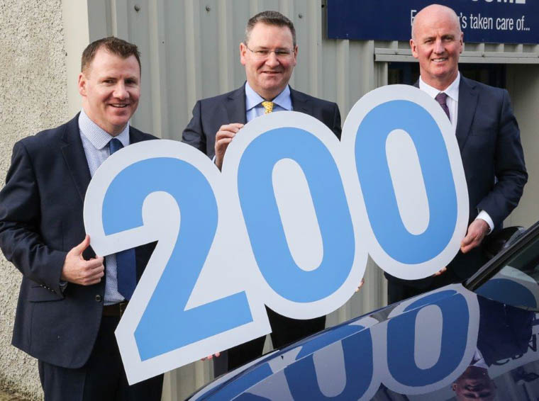 Tony McKeown, Sales & Marketing Director, Jonathan McKeown, CEO and Paul Cooney, Fleet & Repair Director marking their 200th fleet car.