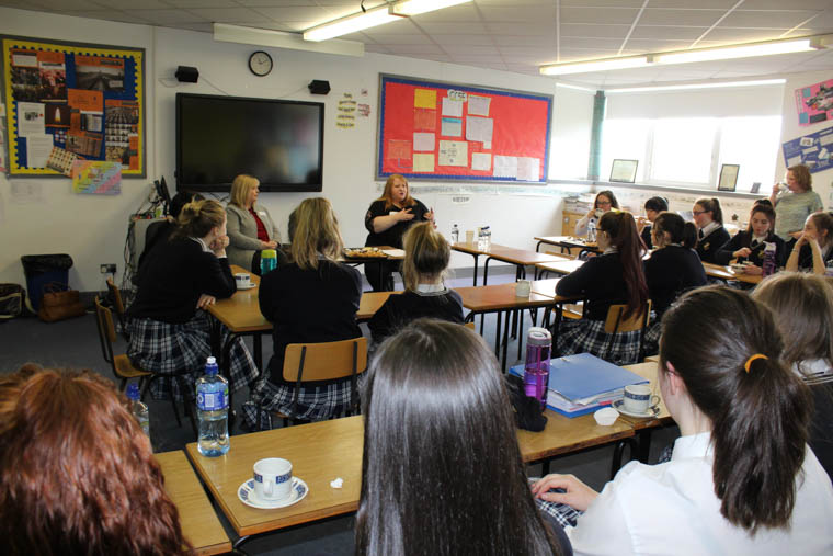 Alliance party leader Naomi Long and Helena Young speaking to students at Our Lady's Grammar School.