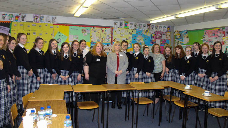 Alliance party leader Naomi Long with party members Helena Young and Jackie Coade pictured with students at Our Lady's Grammar School.