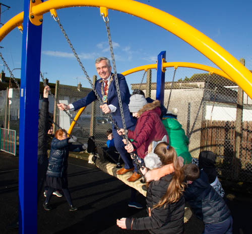 Council Chairman, Councillor Mark Murnin launches the new play park in Barr Crescent, Lurganare. Photographs: NewRayPics.com