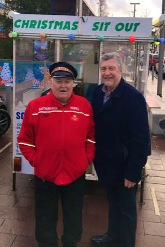 John Dalzell with MP Mickey Brady during his Christmas 2018 Sit Out for Southern Area Hospice.