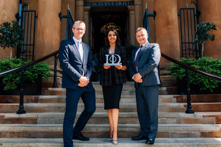 Naoimh McAteer, Director, MJM Group, has been named Young Director of the Year at the Institute of Directors Northern Ireland (IoD NI) Director of the Year Awards. She is pictured following the awards ceremony at the Merchant Hotel, Belfast with, from left, Adrian Moynihan, Head of awards sponsor First Trust Bank and Gordon Milligan, Chairman, IoD NI.