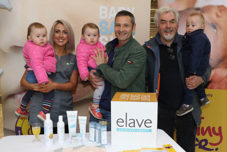 Triplets Rosie, Evie and Oísin, pictured with dad Brian Walsh and grandad Gerry Morgan, receive advice from Aoife Downey, Manager of Medical Hall Pharmacy, Quays Centre, at the Sensitive Skincare Showcase organised by NI premature baby charity TinyLife and Elave Skincare. The triplets were born 2 months premature.