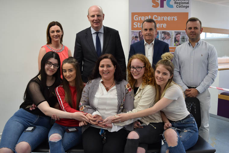 Mr. Brian Doran, Chief Executive at SRC presents the team of students from the Pearson BTEC Level 3 Extended Diploma in Health and Social Care who won the Project Based Learning Award – Overall Award Winner: Back Row (L-R): Tracey Rice – SRC Business Support, Brian Doran – SRC Chief Executive, Tom Kinney – Invest NI (Competition Judge), John Hughes – Brilliant Red (Competition Judge) Front Row (L-R): Caoimhe Campbell, Naomi Pedlow, Kathryn Moore (SRC Lecturer), Kiai Chambers, Hannah McFarland.