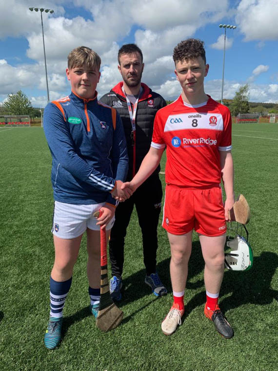 Armagh U15 Captain Conor Reavey pictured with his Derry counterpart and match referee