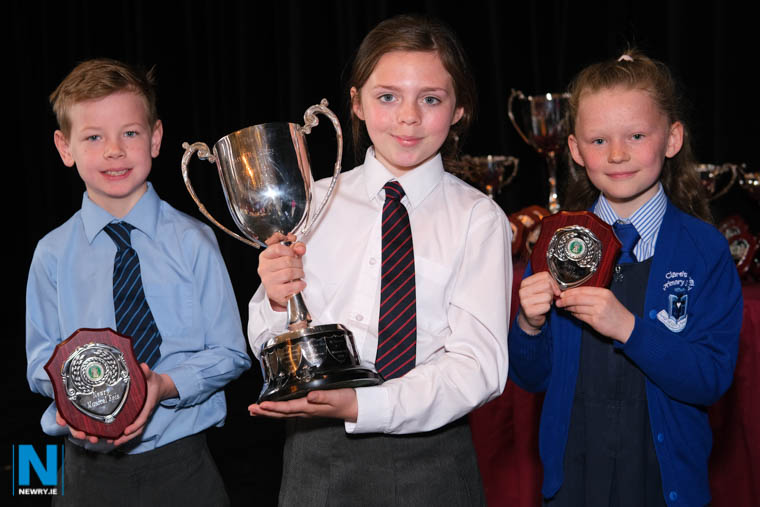 Class 13 Choral Speaking winners at Newry Feis were  Cumran PS, Downpatrick and  Eve McNernin is pictured with the Betty McElroy Cup. Windsor Hill PS, Newry took 2nd and  Jamie Henning, is pictured with the shield while  St Clare's Abbey PS, Newry 3rd place award was collected by Cora McEnhill. Photograph: Columba O'Hare/ Newry.ie