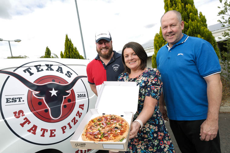 One of the businesses helped by the Go For It programme, in association with Newry, Mourne and Mid Ulster District Council is Texas State Pizza. Co. Down man, Emmanuel McMenamin is proving his dough is rising due to popularity of his business venture, Texas State Pizza.   Emmanuel, who's getting a slice of the action with his new business, credits his success down to his pizza base, created from a recipe formulated by a Texan who works alongside Emmanuel and the temperature of the oven, he says, 'people are even eating the crusts'.  Jason and Emmanuel from Texas State Pizza are pictured with business advisor at Down Business Centre, Joan Tummon.