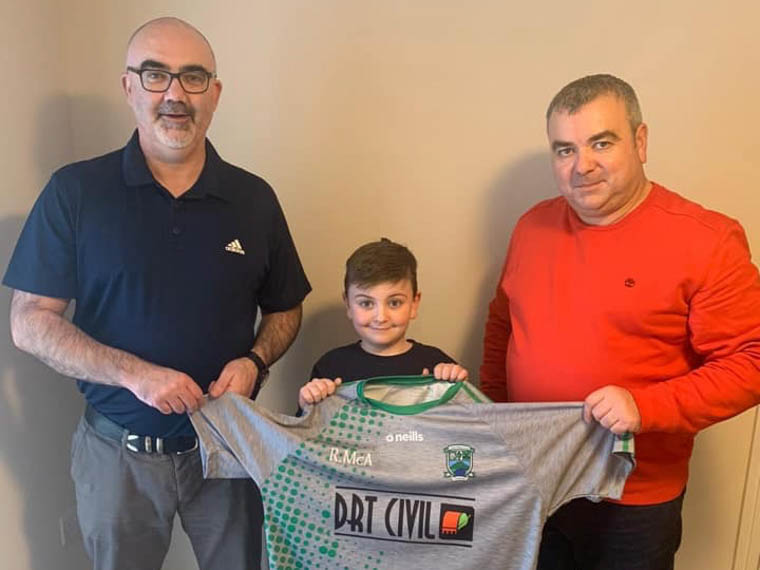 Former Shane's footballer and now Australian resident Ronan Mc Anulty took time out during his visit home to present Shane's chairman Brendy Osborne with underage training tops on behalf of his company, DRT Civil. Also pictured is Ronan's son Tiernan who took part in a couple of underage training sessions during his trip to Ireland.