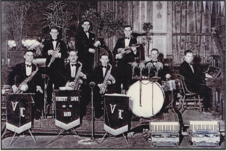 Vincent Lowe and his Band. Band leader Vincent Lowe is seen (right) at the piano and his young bassist, Frank Hall is seen standing (centre at back).