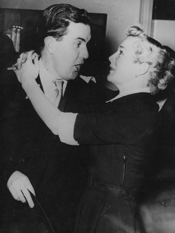 ANNIE GETS HER MAN... Newry man Frank Hall, then a nightly columnist with Dublin's Evening Herald, pictured in the embrace of glamorous Hollywood film star, Betty Hutton. The picture was taken during her 1950s visit to Dublin to promote the MGM hit musical 'Annie Get Your Gun' in which she had the starring role playing the part of Annie Oakley alongside the equally renowned Howard Keel. 