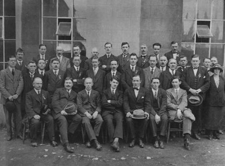Éamon Donnelly was the Ulster Organiser for Sinn Féin in the 1921 election campaign and was Michael Collin's election agent in Armagh. This photograph features Michael Collins, with a reception committee outside City Hall, Armagh. Front row from left to right: Michael Garvey, Seán Ó Muirthile (Sean Hurley), Éamon Donnelly, Michael Collins, Harry Boland, Tom Cullen (Collins's bodyguard), Joseph Dolan. Courtesy of Donal Donnelly-Wood