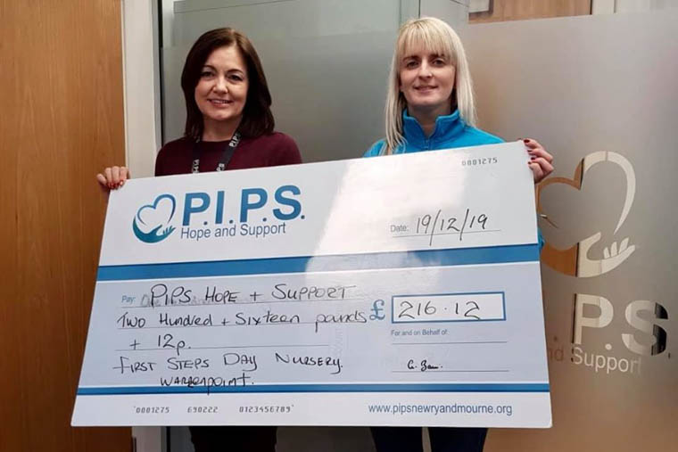 Allison Slater (First Steps Day Care Nursery) presenting PIPS Hope and Support's Manager Dympna Maguire with the Cheque.