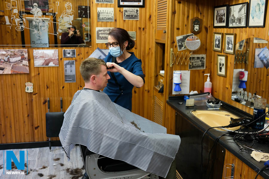 It's back to work for Eva Devine, Gerry's Barber Shop, Newry with Sean McAlinden in the hot seat. Photograph: Columba O'Hare/ Newry.ie
