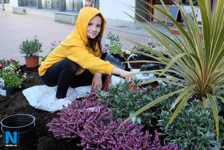 Grace McElherron hard at work brightening up Newry. Photograph: Columba O'Hare/ Newry.ie