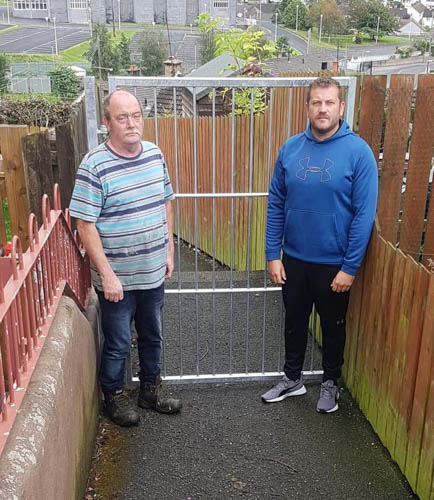 Stephen Murney and Anthony Coyle from Derrybeg Community Association have welcomed the fitting of alley gates in Derrybeg.