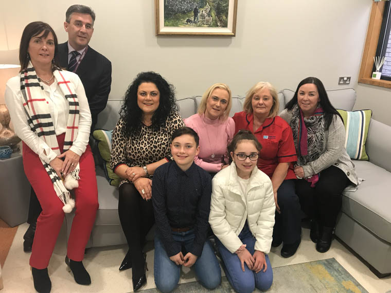 Belinda and son Leo and Claudia and daughter Kyla with Interim Director for Acute Services Melanie McClements, Assistant Director Ronan Carroll, Sister Ruth McParland and Dr Helena Murray in the transformed Family Consultation Room in the ICU.