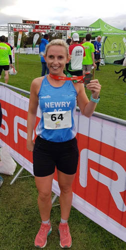 Sarah Jane Beattie with a well earned finisher medal at the Spar XC, Dublin