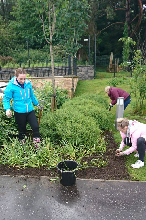 M&S volunteers hard at work in the St Clare's Abbey garden.