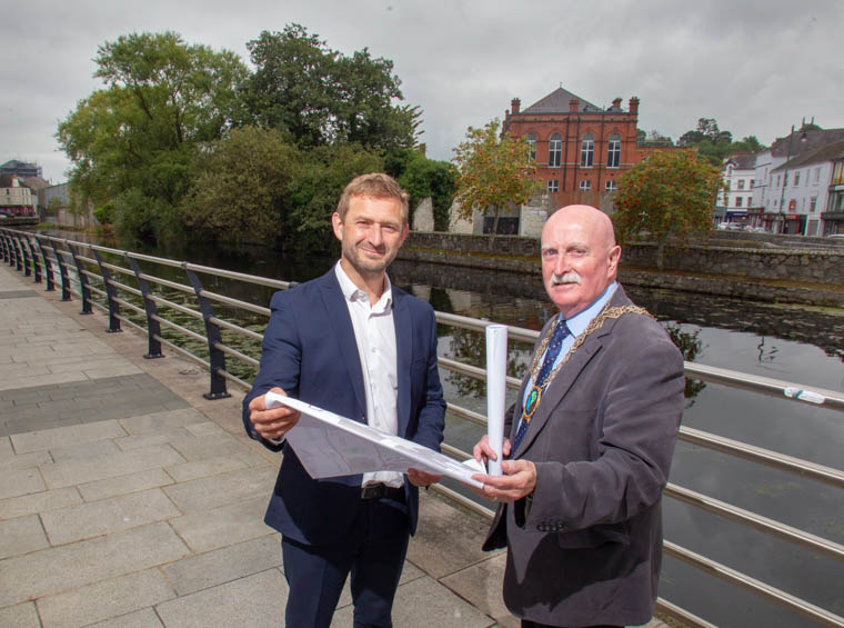 Newry, Mourne and Down District Chairperson Councillor Charlie Casey overlooking the CCR proposals with Project Director Adrian Grimshaw.