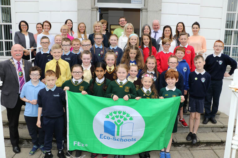 Chairperson Newry, Mourne and Down District Council, Councillor Charlie Casey with Council Staff, Eco School Co-ordinators and Eco School Council from Primary Schools who received their First Green Flag at the Annual Green Flag Ceremony in Warrenpoint Town Hall on Tuesday 25th June 2019.